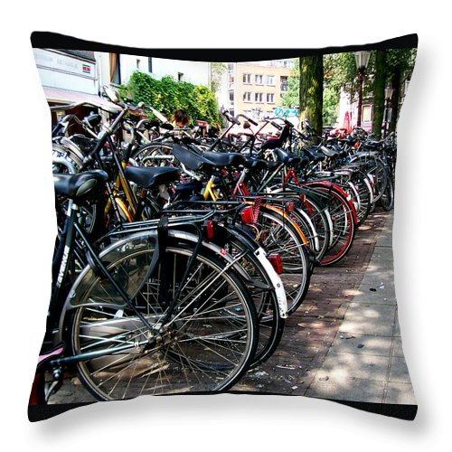 Bicycle Throw Pillow featuring the photograph Bicycle Parking Lot by Glenn Aker