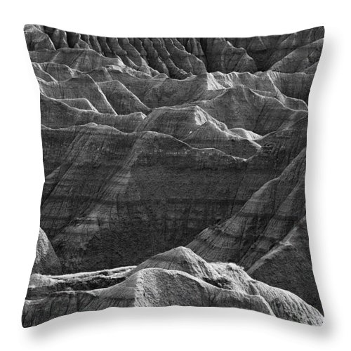 Outdoors Throw Pillow featuring the photograph Black And White Image Of The Badlands by Robert Postma