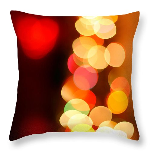 Christmas Throw Pillow featuring the photograph Blurred Christmas Lights by Gaspar Avila