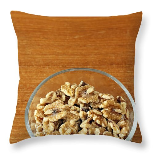 Shelled Throw Pillow featuring the photograph Bowl Of Shelled Walnuts by Lee Serenethos