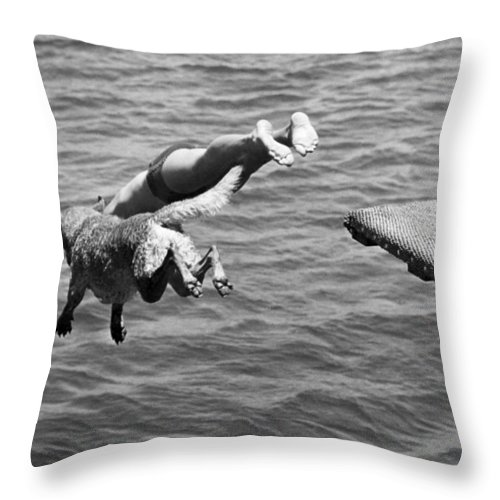1940 Throw Pillow featuring the photograph Boy And His Dog Dive Together by Underwood Archives