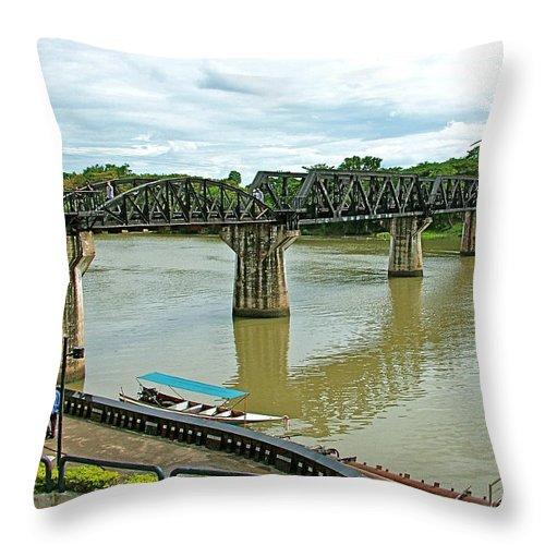 Bridge Over River Kwai In Kanchanaburi Throw Pillow featuring the photograph Bridge Over River Kwai In Kanchanaburi-thailand by Ruth Hager