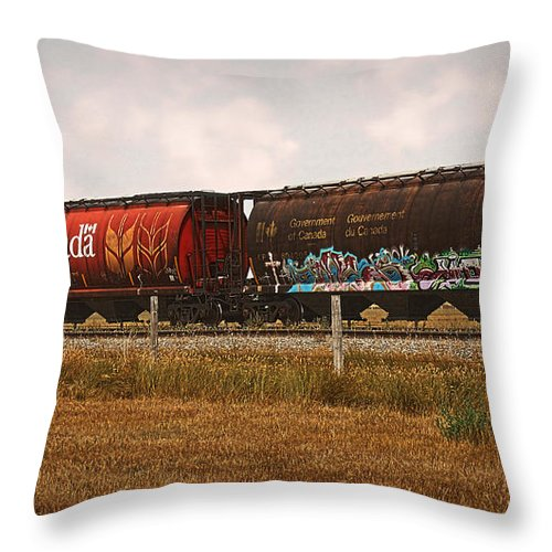 Railroad Throw Pillow featuring the photograph Bringing In The Wheat Canadian Railroad by Terry Fleckney