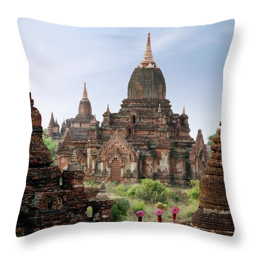 Tranquility Throw Pillow featuring the photograph Buddhist Monks Walking Past Temple by Martin Puddy