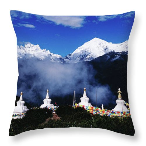Chinese Culture Throw Pillow featuring the photograph Buddhist Stupas And Prayer Flags With by Richard I'anson