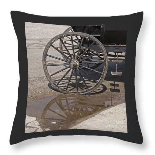 Amish Throw Pillow featuring the photograph Buggy Wheels by Ann Horn