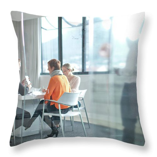 Young Men Throw Pillow featuring the photograph Businesspeople Having Meeting At by Zero Creatives