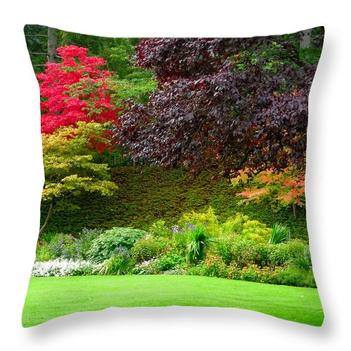 Fall Throw Pillow featuring the photograph Butchart Gardens Lawn And Tree by Brian Hoover