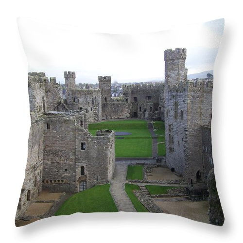 Castles Throw Pillow featuring the photograph Caernarfon Castle by Christopher Rowlands