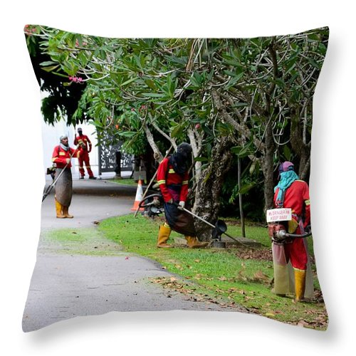 Men Throw Pillow featuring the photograph Camouflaged Leaf Blowers Working In Singapore Park by Imran Ahmed