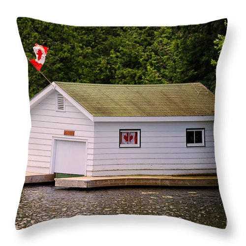 Boathouse Throw Pillow featuring the photograph Canadian Boathouse by Les Palenik