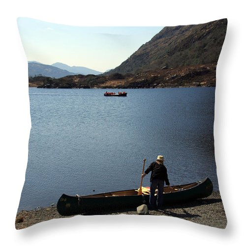 Ireland Throw Pillow featuring the photograph Canoe By The Lake by Aidan Moran