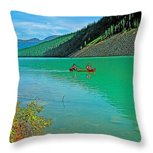 Canoe On Lake Louise In Banff National Park Throw Pillow featuring the photograph Canoe On Lake Louise In Banff Np-alberta by Ruth Hager