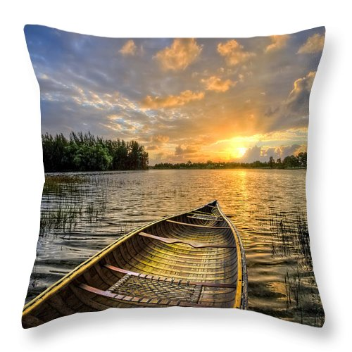 Boats Throw Pillow featuring the photograph Canoeing At Sunrise by Debra and Dave Vanderlaan