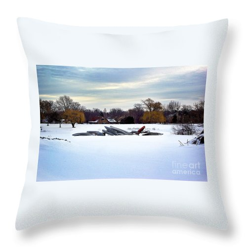 Canoe Throw Pillow featuring the photograph Canoes In The Snow by Frank J Casella