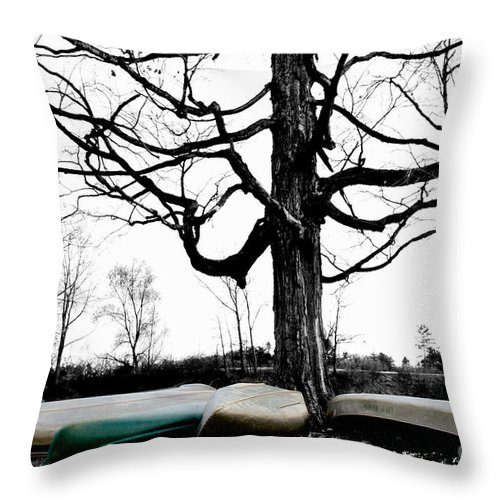 Boats Throw Pillow featuring the photograph Canoes In Winter by Michael Arend