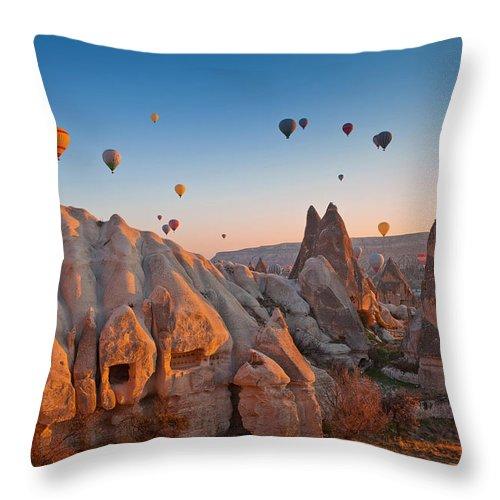 Wind Throw Pillow featuring the photograph Cappadocia, Turkey by Benstevens