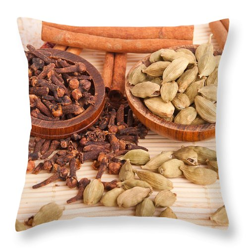 Spices Throw Pillow featuring the photograph Cardamom Pods And Cloves by Luis Alvarenga