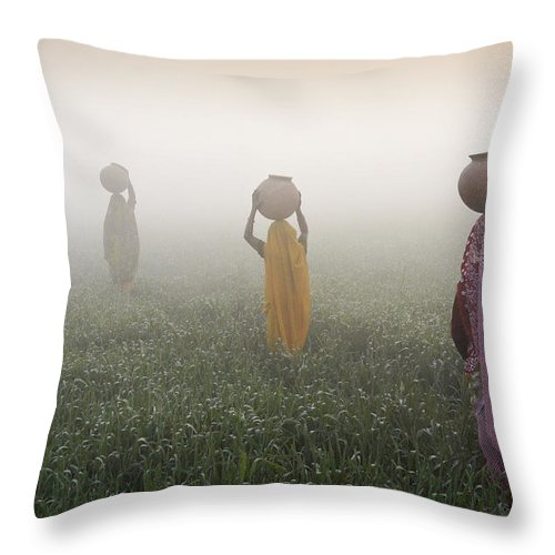 Asia Throw Pillow featuring the photograph Carrying Water On A Foggy Morn In India by Michele Burgess