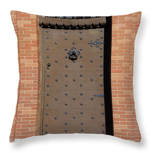 Door Throw Pillow featuring the photograph Castle Door by Laurie Perry