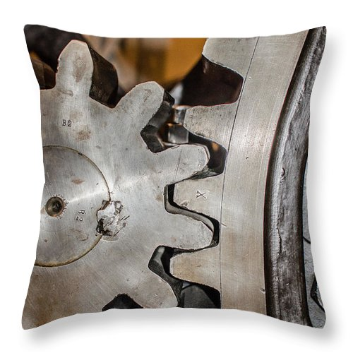 Cogwheels Throw Pillow featuring the photograph Cause And Effect by Andreas Berthold