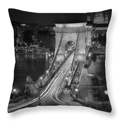 Joan Carroll Throw Pillow featuring the photograph Chain Bridge Night Traffic Bw by Joan Carroll