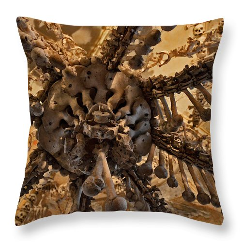 Sedlec Ossuary Throw Pillow featuring the photograph Chandelier Made Of Bones And Skulls. by Andy Za