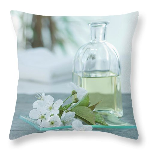 Spa Throw Pillow featuring the photograph Cherry Blossom With Aroma Oil, Close Up by Westend61