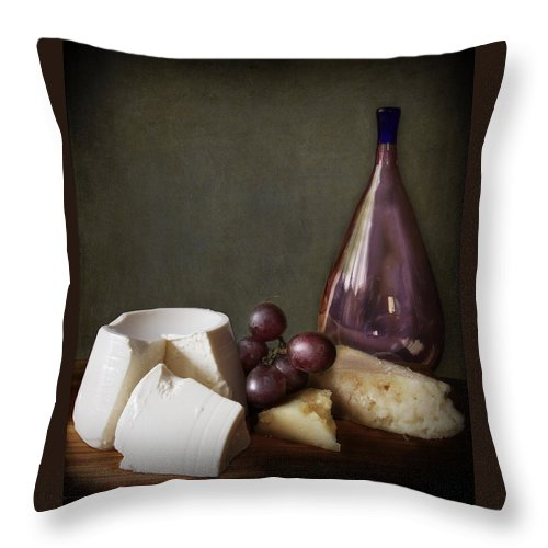 Board Throw Pillow featuring the photograph Chiaroscuro Still Life With Grapes Cheese And Bottle by Luisa Vallon Fumi