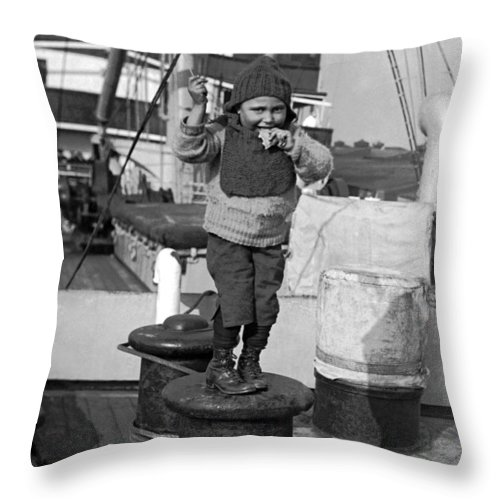 1926 Throw Pillow featuring the photograph Child Arriving At Ellis Island by Underwood Archives