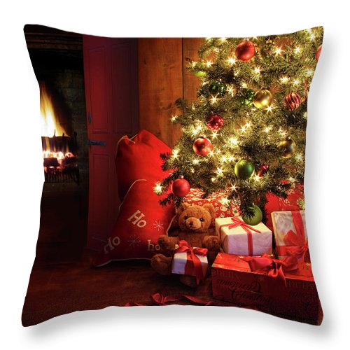 Bright Throw Pillow featuring the photograph Christmas Scene With Tree And Fire In Background by Sandra Cunningham
