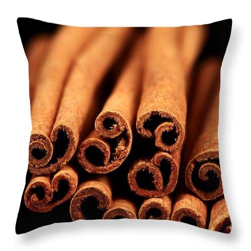 Cinnamon Sticks Throw Pillow featuring the photograph Cinnamon Sticks by John Rizzuto
