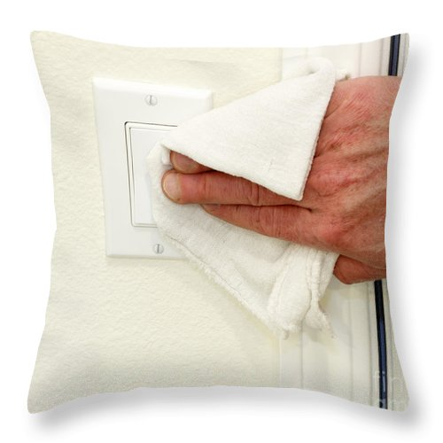 Cleaning Throw Pillow featuring the photograph Cleaning A Light Switch by Lee Serenethos