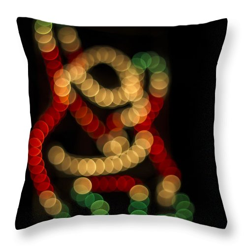 Clare Bambers Throw Pillow featuring the photograph Climbing Santa by Clare Bambers