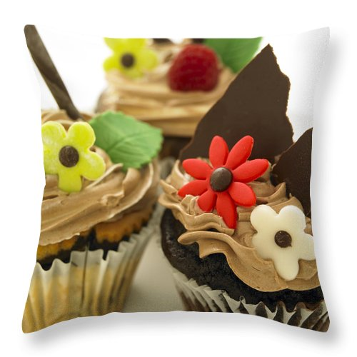 Color Throw Pillow featuring the photograph Close-up Of Three Chocolate Cupcakes by Works Photography
