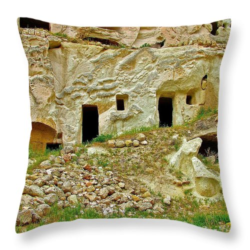 Close-up Of Tufa-carved Homes In Cappadocia Throw Pillow featuring the photograph Close-up Of Tufa-carved Homes In Cappadocia-turkey by Ruth Hager