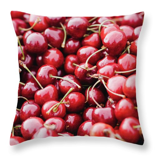Cherry Throw Pillow featuring the photograph Closeup Of Fresh Cherries by Miemo Penttinen - Miemo.net