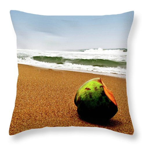 Tranquility Throw Pillow featuring the photograph Coconut On Sandy Beach With Waves And by Amlan Mathur
