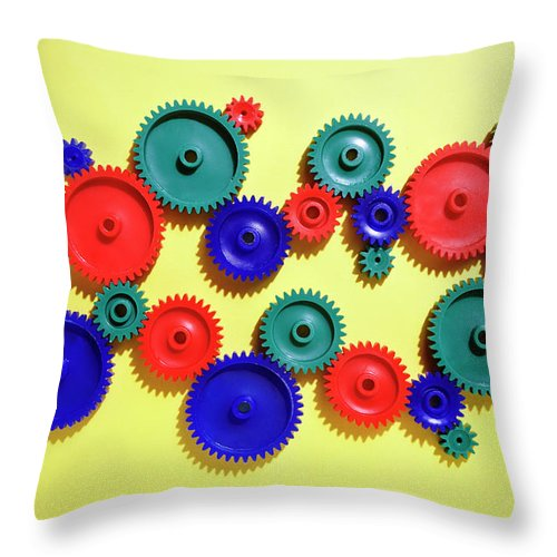 Working Throw Pillow featuring the photograph Colored Gears by Joseph Clark