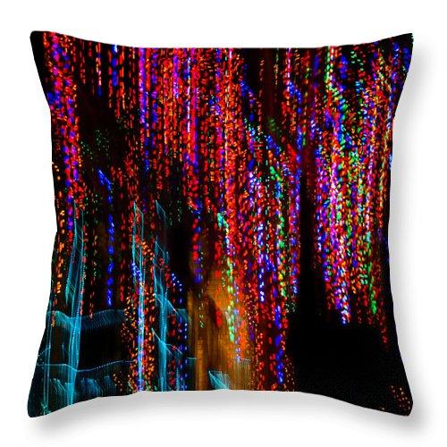 Colorful Christmas Streaks Throw Pillow featuring the photograph Colorful Christmas Streaks - Abstract Christmas Lights Series by Georgia Mizuleva