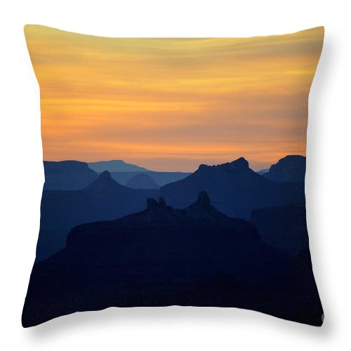 Travelpixpro Grand Canyon Throw Pillow featuring the photograph Colorful Dawn Sky Over Silhouetted Spires In Grand Canyon National Park by Shawn O'Brien