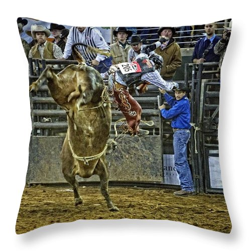 Bullrider Throw Pillow featuring the photograph Coming Off by Alice Gipson