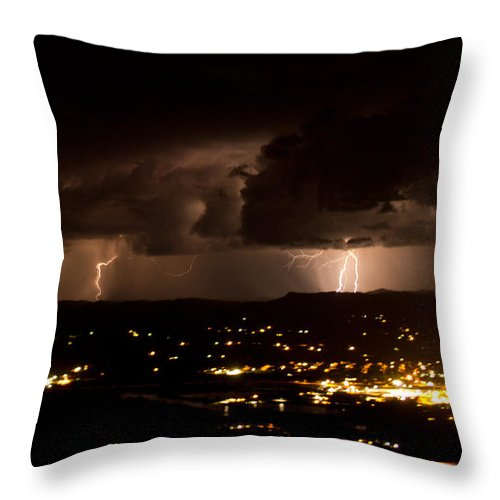 Lightning Throw Pillow featuring the photograph Competing Storms by Dawn Morrow