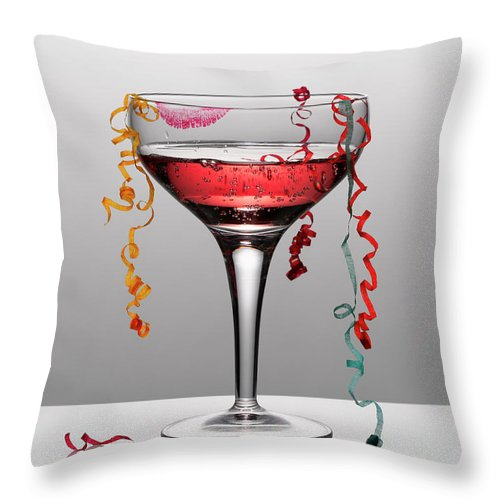 Streamer Throw Pillow featuring the photograph Confetti Hanging From Glass Of Pink by Andy Roberts