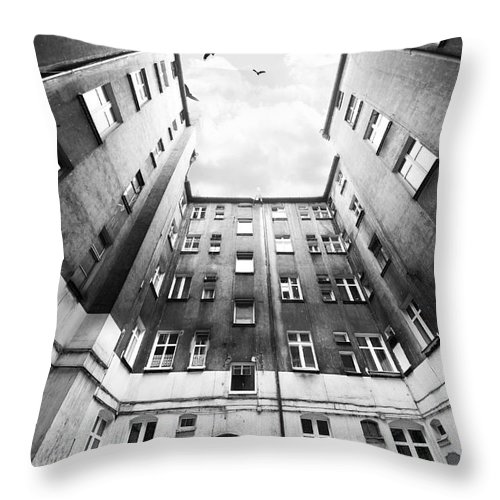 Courtyard Throw Pillow featuring the photograph Courtyard In Black And White by Jaroslaw Blaminsky
