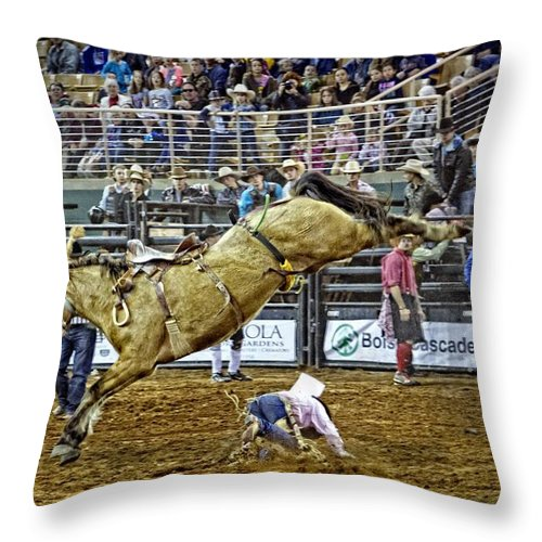 Bronc Rider Throw Pillow featuring the photograph Cowboy Down by Alice Gipson