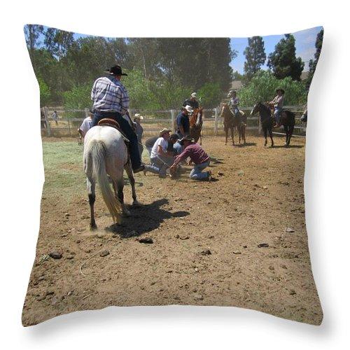 Cowboys Throw Pillow featuring the photograph Cowboys At The Branding by Steve Scheunemann