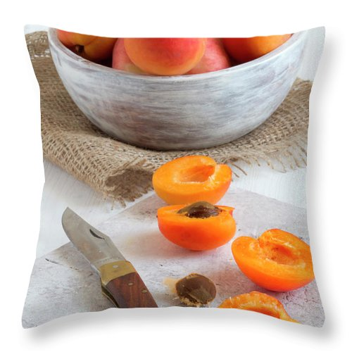 Cutting Board Throw Pillow featuring the photograph Cross Section Apricots With Knife And by Westend61