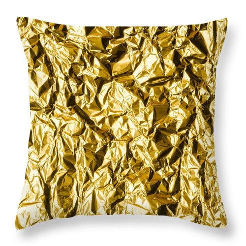 Abstract Throw Pillow featuring the photograph Crumpled Gold Foil by Alain De Maximy