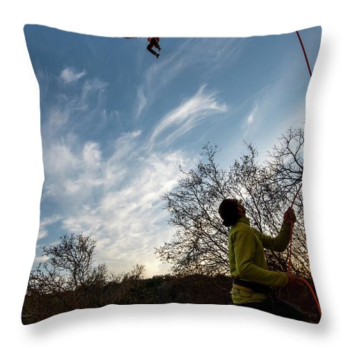 Endurance Throw Pillow featuring the photograph Cutting Feet At Sunset by Jacob Bodkin